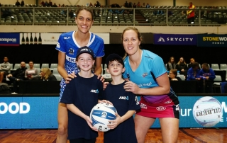 ANZ Future Captains Matilda Adams aged 10 and Sebastian Adams aged 8 pose for a photo with Anna Harrison of the Mystics and Wendy Frew of the Steel prior to the match. 2018 ANZ Pre